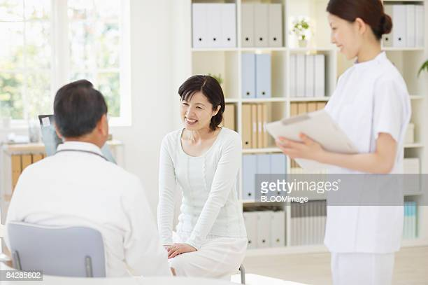 Senior male doctor talking to patient