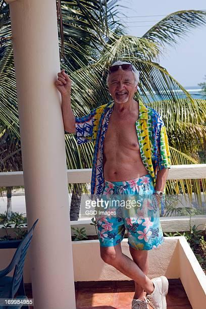 Senior male dressed for beach