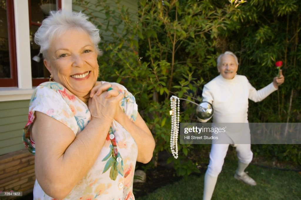Senior male fencer with pearls at end of epee for senior woman : Stock Photo