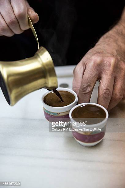 Senior male hands pouring traditional Moroccan coffee