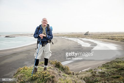 Senior male hiker standing on cliff top