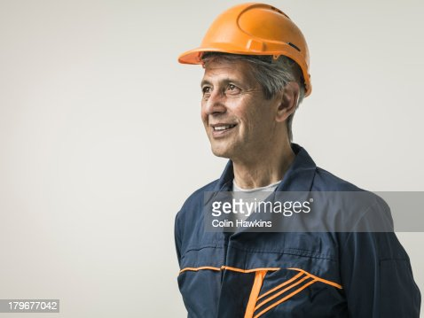 Senior male in protective clothing