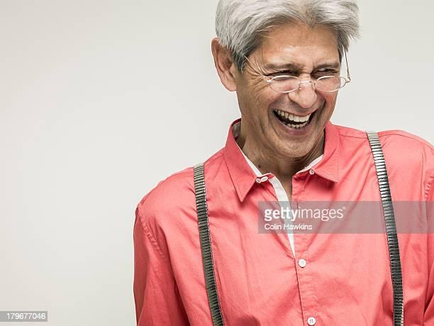 Senior male laughing
