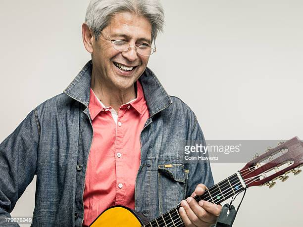 Senior male playing guitar