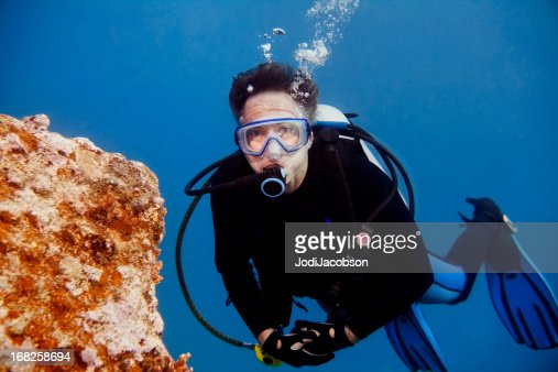 Senior Male Scuba Diver looking at camera with copy space