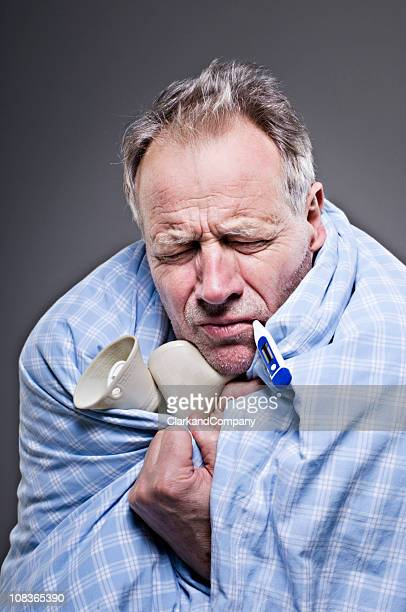 Senior Male Suffering With A Cold or Man Flu