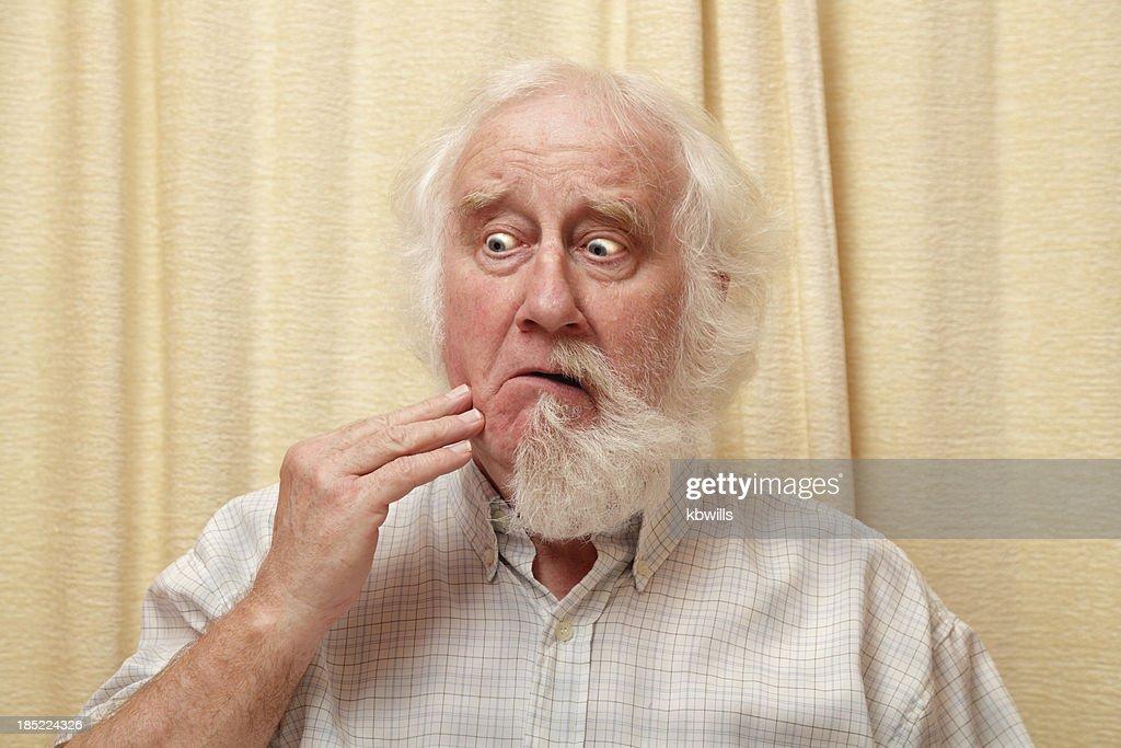 senior male surprised by vanishing beard