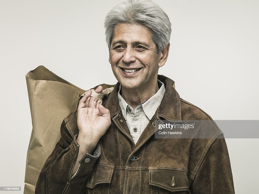 Senior male with shopping bag : Stock Photo