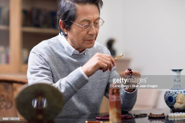 Senior man admiring antiques