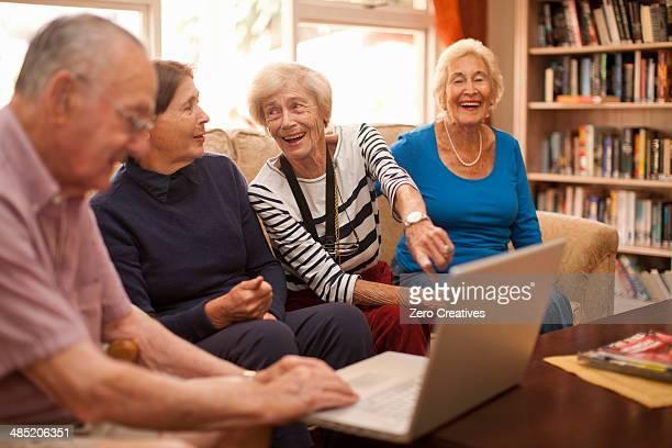 Senior man and female companions in retirement villa