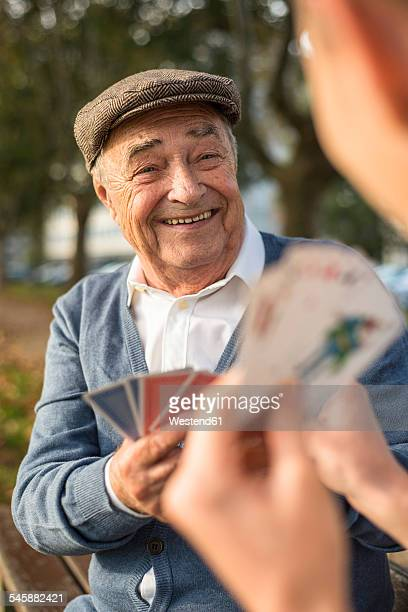 Senior man and grandson playing cards