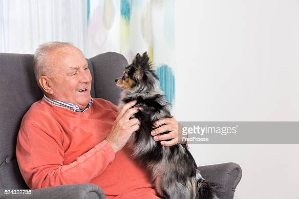 Senior man and his Chihuahua at home