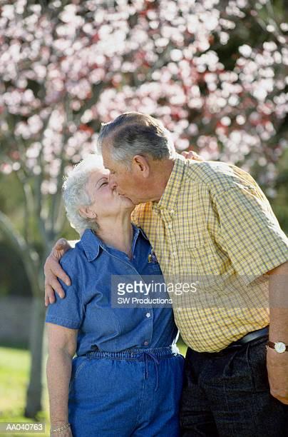 Senior man and woman kissing