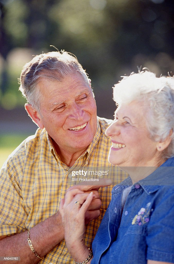 Senior man and woman laughing : Stock Photo