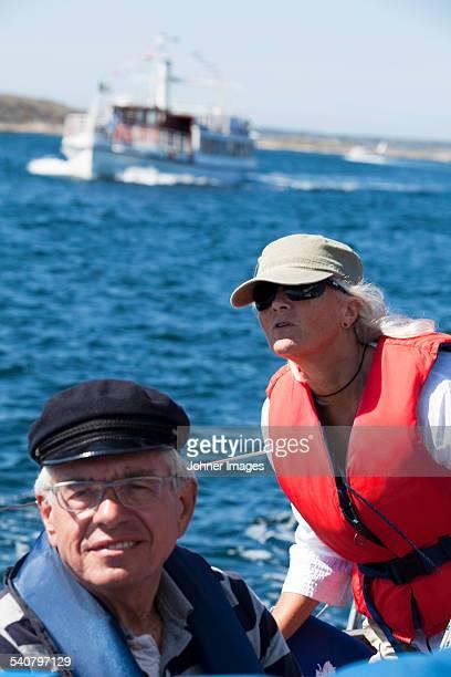 Senior man and woman sailing