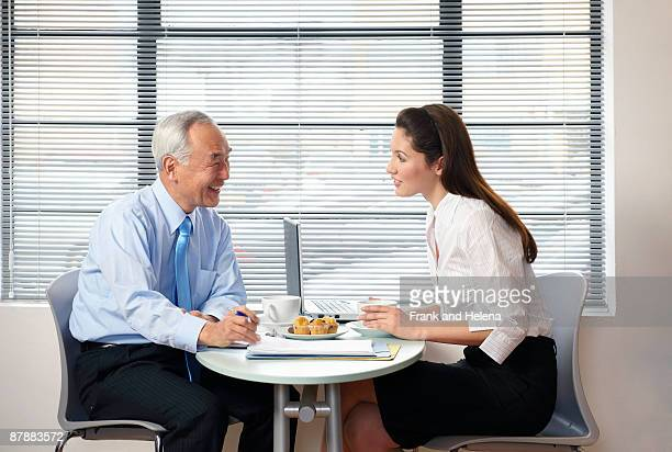 Senior man and woman working in cafe