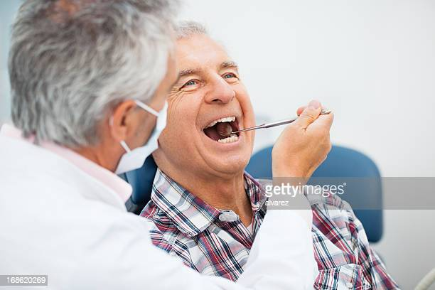 Senior man at the dentist