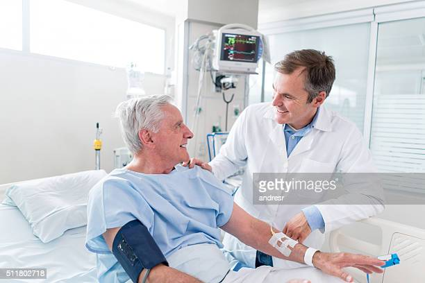 Senior man at the ICU talking to the doctor