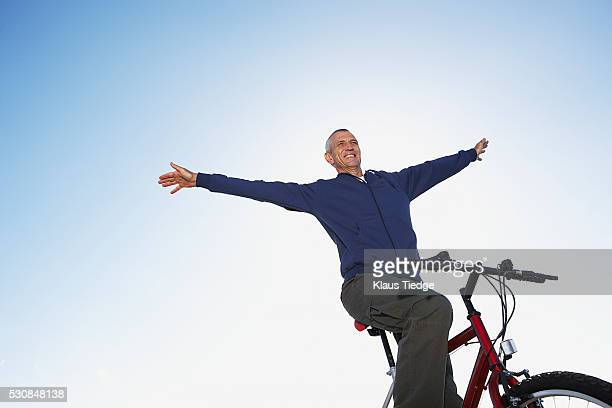Senior man biking
