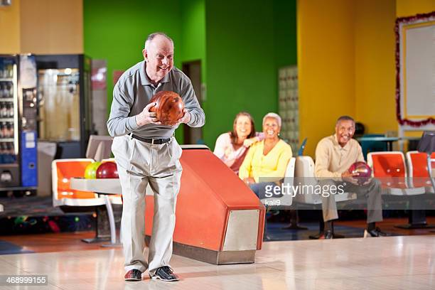 Senior man bowling