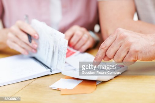 Senior man calculating expenses with woman