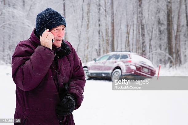 Senior man calling for help during snow storm