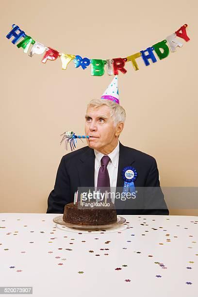 Senior man celebrating birthday, indoors