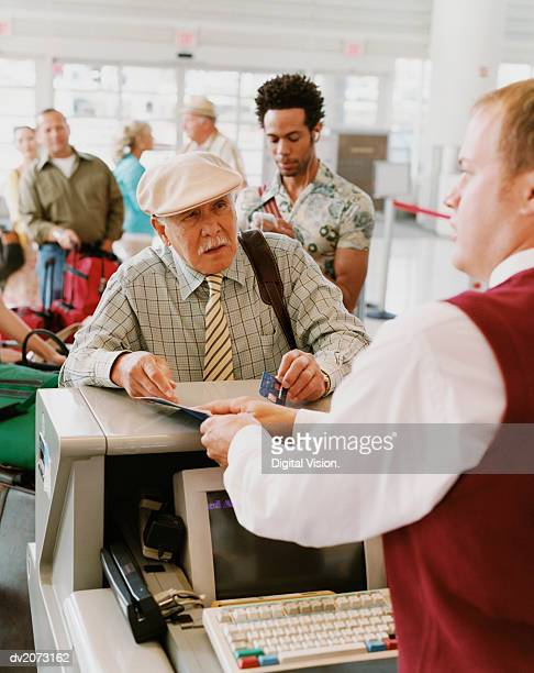 Senior Man Checks Into an Airport With a Credit Card