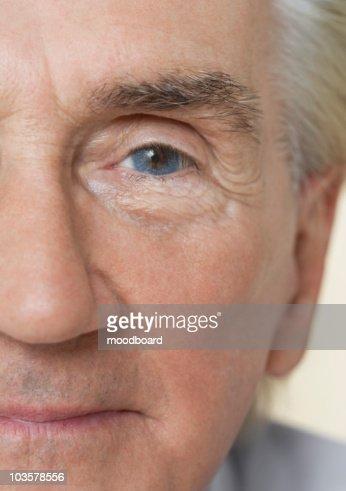 Senior Man, close up of half of face : Stock Photo