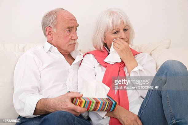 Senior man comforting crying woman
