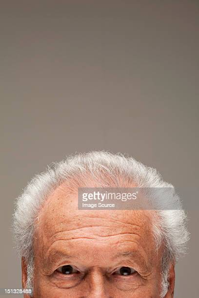 Senior man, cropped portrait