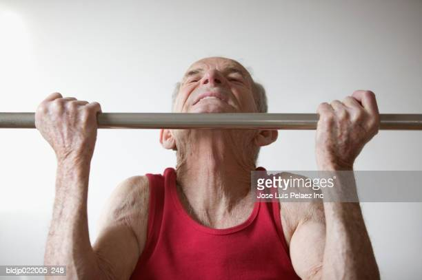 Senior man doing chin-ups