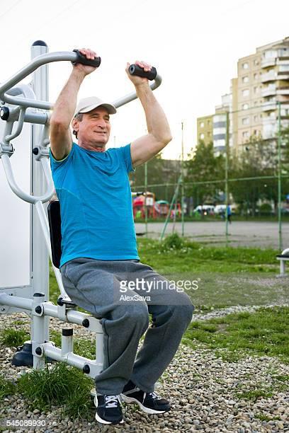 Senior man doing strength workout outdoor
