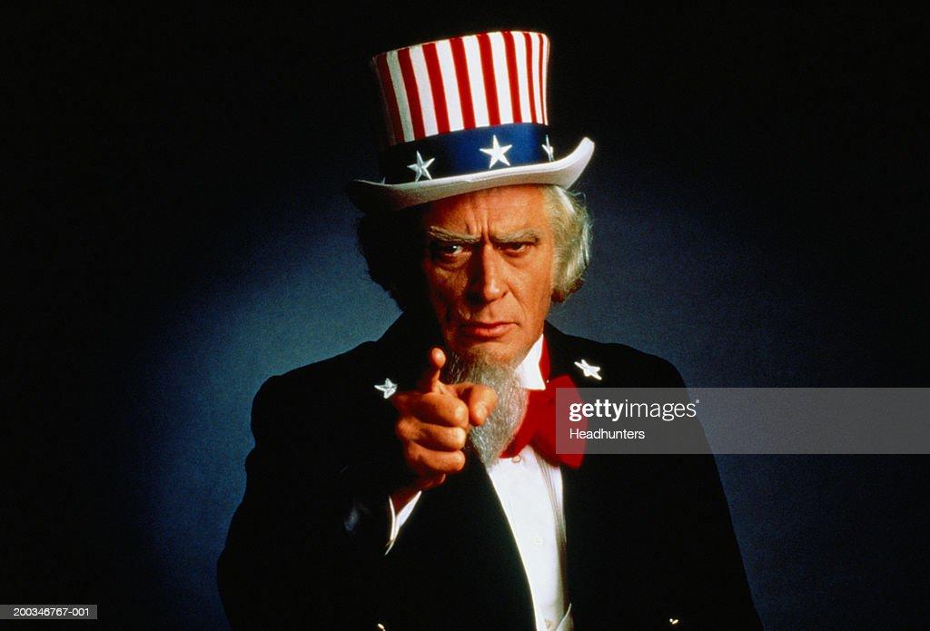 Senior man dressed as 'Uncle Sam' pointing finger
