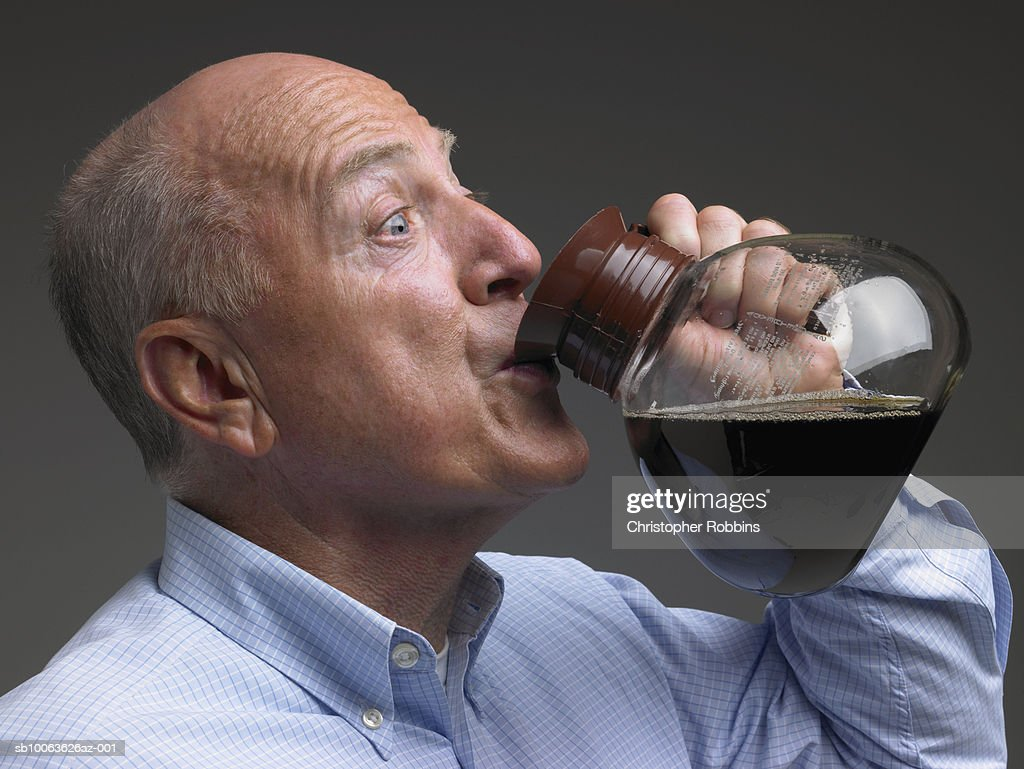Senior man drinking coffee from pot : Stock Photo