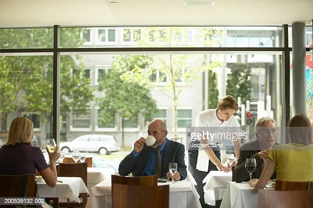 Senior man drinking coffee in restaurant
