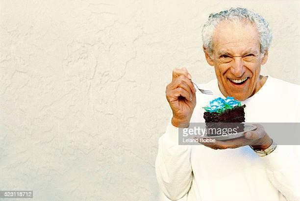 Senior Man Eating Chocolate Cake