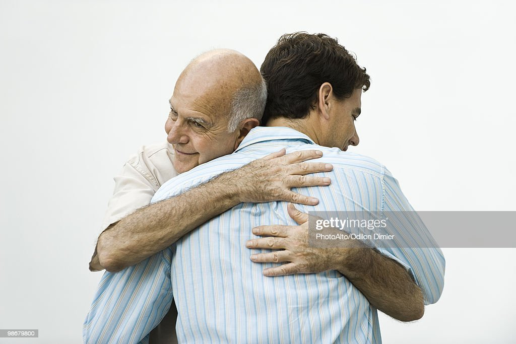Senior man embracing adult son