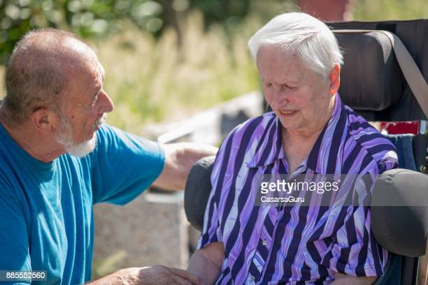 Senior Man Encouraging And Comforting Senior Woman In The Nursing Home
