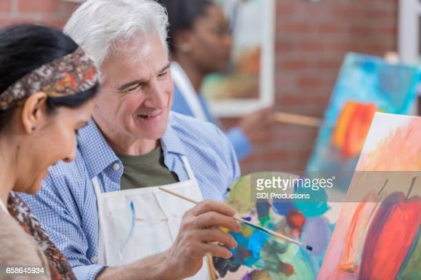 Senior man enjoys art class