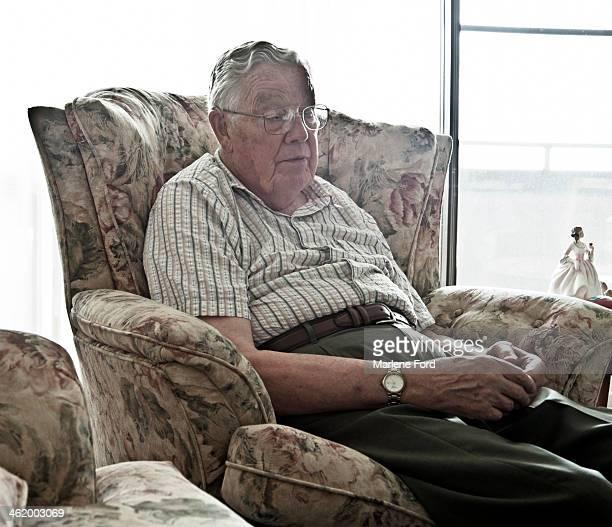 Senior man falling asleep in a chair