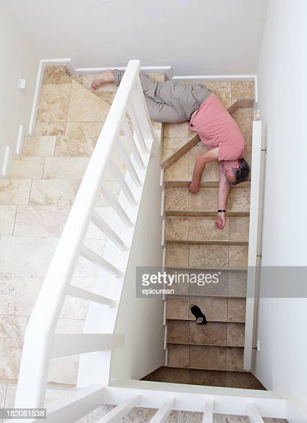 Senior man falling down a flight of stairs