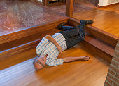 Senior man fell down the stairs onto wood floor