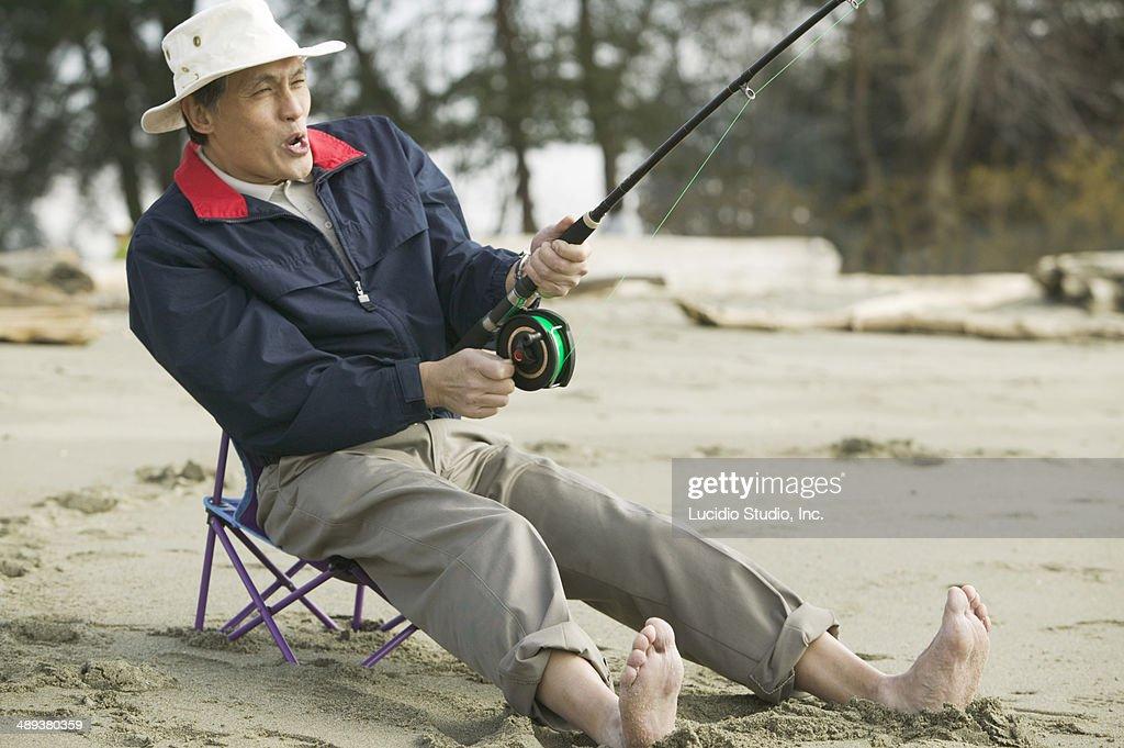Senior man fishing : Stock Photo