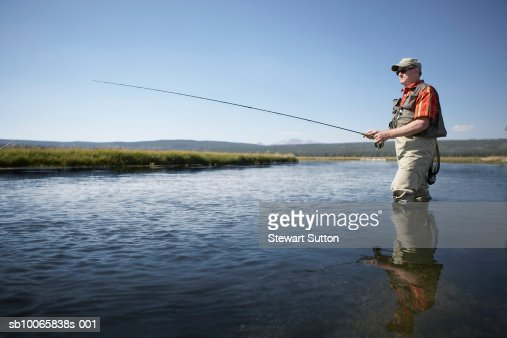 Senior man flyfishing in river