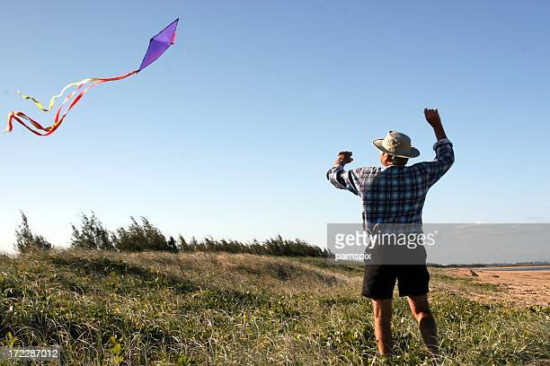 Senior man flying a kite