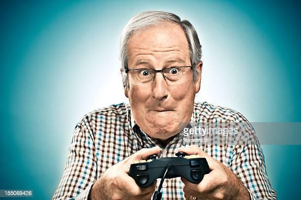Senior man Game Playing