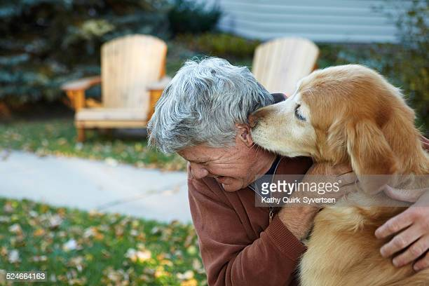 Senior man getting a kiss from his dog