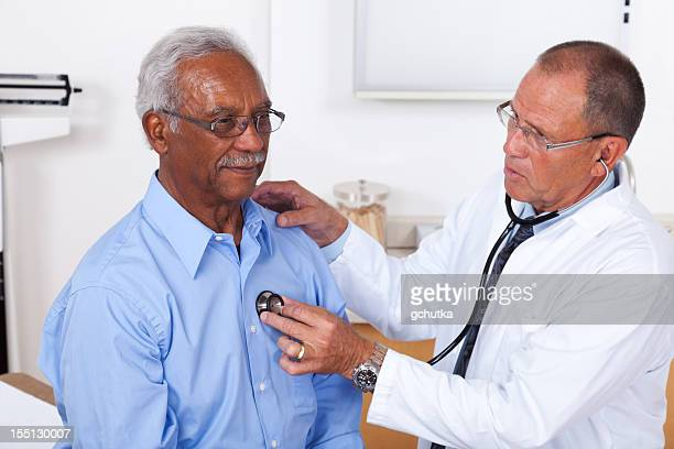 Senior man getting check up from Doctor with stethoscope