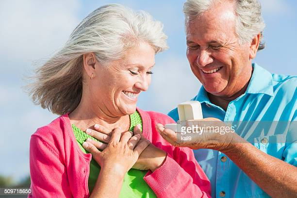 Senior man giving wife an anniversary gift